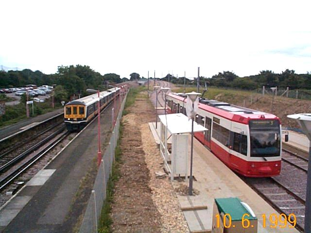 Train and Tram at Mitcham Junction
